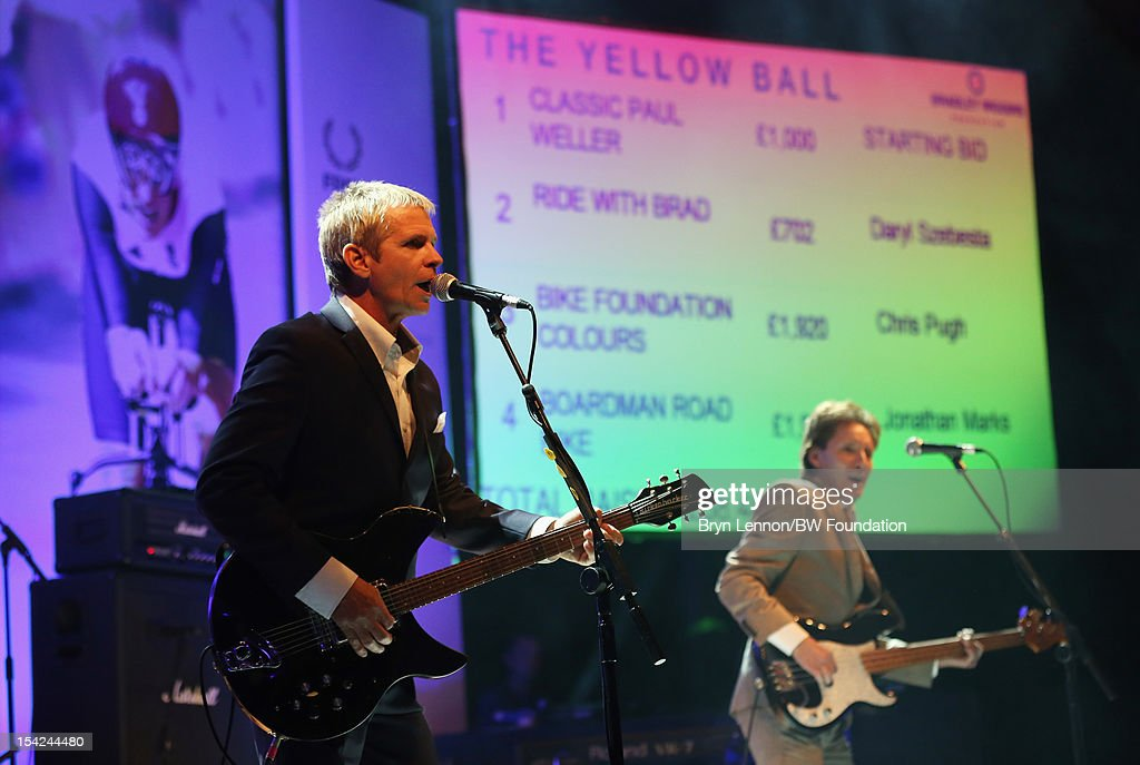 Russel Hastings and Bruce Foxton play at the Bradley Wiggins Foundation 'The Yellow Ball' event at The Roundhouse on October 16, 2012 in London, England. The dinner and entertainment show was held to celebrate the historic achievements of Great Britain's cyclist Bradley Wiggins in 2012, including his Tour de France win and Olympic gold achievements. The Foundation aims to promote participation in sport, to encourage young people to exercise regularly, and to support athletes from all sports to take their talent to the next level.