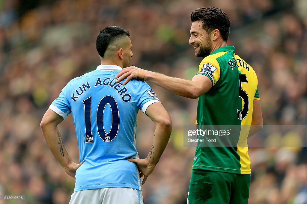 Russel Martin of Norwich City and Sergio Aguero of Manchester City talk during the Barclays Premier League match between Norwich City and Manchester...