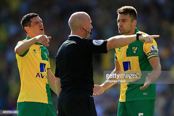 Russel Martin of Norwich City appeals to referee Simon Hooper after their second goal was disallowed during the Barclays Premier League match between...