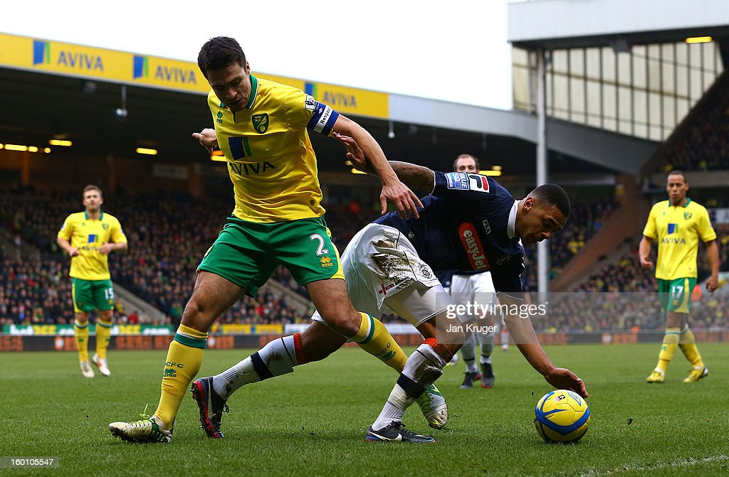 Russel Martin of Norwich City battles with Andy Gray of Luton Town during the FA Cup with Budweiser fourth round match between Norwich City and Luton Town at Carrow Road on January 26, 2013 in Norwich, England.