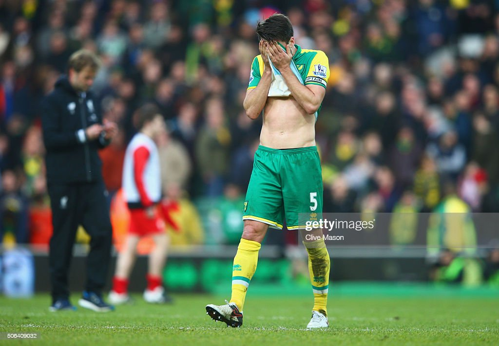 Russel Martin of Norwich City shows his dejection after his team's 45 defeat in the Barclays Premier League match between Norwich City and Liverpool...
