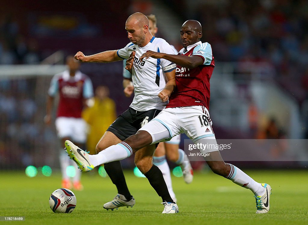 Russel Penn of Cheltenham Town battles with <a gi-track='captionPersonalityLinkClicked' href=/galleries/search?phrase=Alou+Diarra&family=editorial&specificpeople=465019 ng-click='$event.stopPropagation()'>Alou Diarra</a> of West Ham United during the Capital One Cup second round match between West Ham United and Cheltenham Town at The Boleyn Ground on August 27, 2013 in London, England.