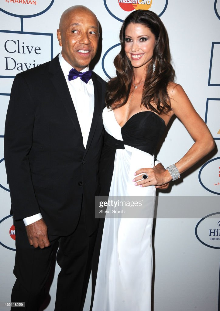 Russel Simmons and <a gi-track='captionPersonalityLinkClicked' href=/galleries/search?phrase=Shannon+Elizabeth&family=editorial&specificpeople=201622 ng-click='$event.stopPropagation()'>Shannon Elizabeth</a> arrives at the Clive Davis And The Recording Academy Annual Pre-GRAMMY Gala at The Beverly Hilton Hotel on January 25, 2014 in Beverly Hills, California.