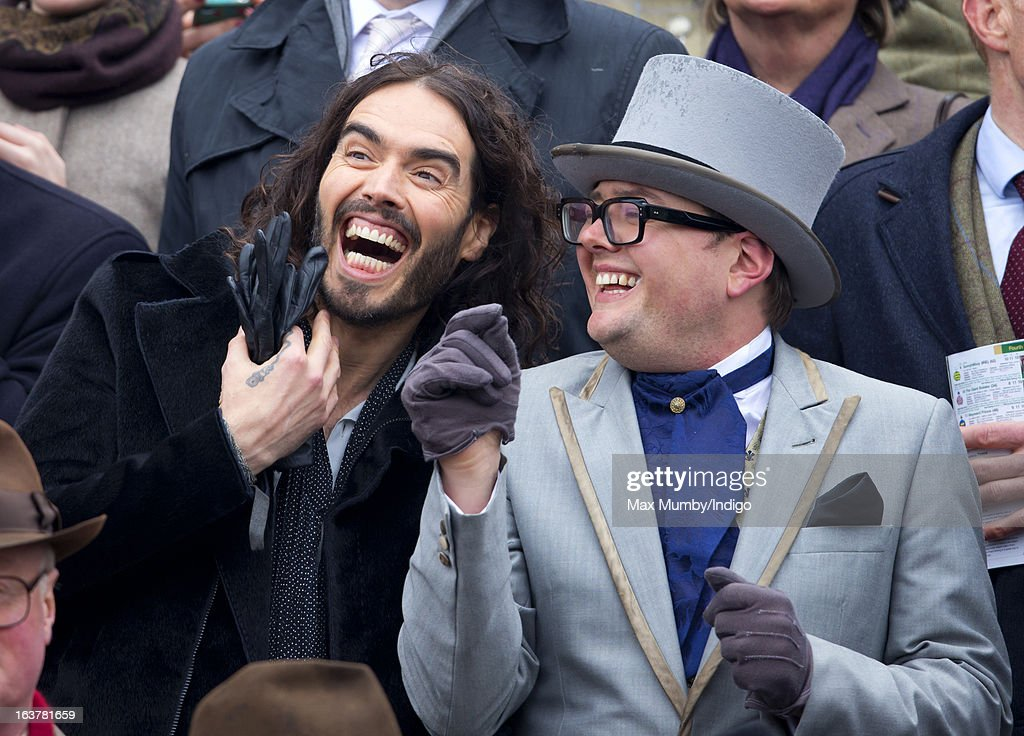 <a gi-track='captionPersonalityLinkClicked' href=/galleries/search?phrase=Russell+Brand&family=editorial&specificpeople=536593 ng-click='$event.stopPropagation()'>Russell Brand</a> and <a gi-track='captionPersonalityLinkClicked' href=/galleries/search?phrase=Alan+Carr&family=editorial&specificpeople=559469 ng-click='$event.stopPropagation()'>Alan Carr</a> watch the racing as they attend Day 4 of The Cheltenham Festival at Cheltenham Racecourse on March 15, 2013 in London, England.