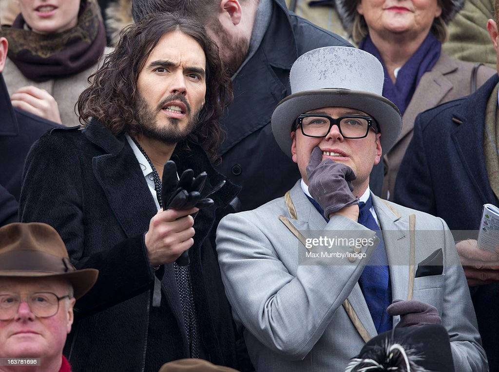 Russell Brand and Alan Carr watch the racing as they attend Day 4 of The Cheltenham Festival at Cheltenham Racecourse on March 15, 2013 in London, England.