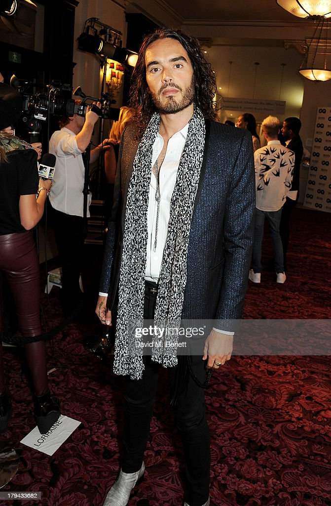 Russell Brand arrives at the GQ Men of the Year awards at The Royal Opera House on September 3, 2013 in London, England.