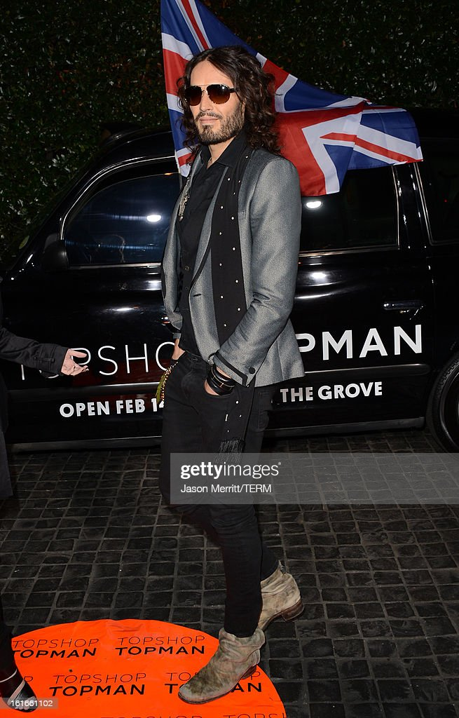Russell Brand arrives at the Topshop Topman LA Opening Party at Cecconi's West Hollywood on February 13, 2013 in Los Angeles, California.