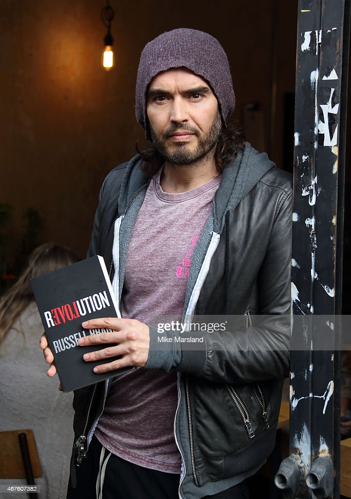Russell Brand opens the Trew Era Cafe on March 26, 2015 in London, England. The Trew Era Cafe is a social enterprise community project on the New Era estate. Russell Brand will be donating 100% of his money for his book 'Revolution' to The Trew Era Cafe.