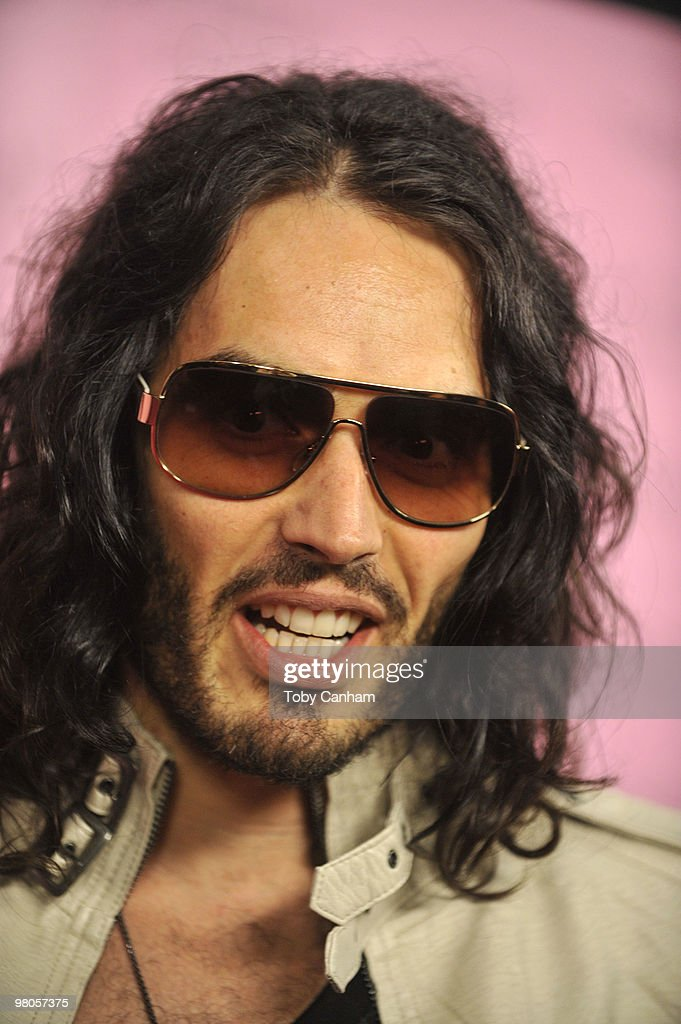 Russell Brand poses for a picture at the 15th Anniversary of Victoria's Secret SWIM catalogue held at Trousdale on March 25, 2010 in Los Angeles, California.