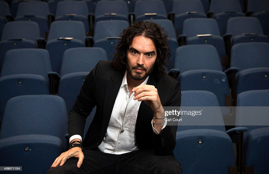 Russell Brand poses for photographs as he arrives to deliver The Reading Agency Lecture at The Institute of Education on November 25, 2014 in London, England. Russell Brand will deliver 'a manifesto on reading' which will be in part personal, sharing his own experience of books and reading while growing up in the UK.
