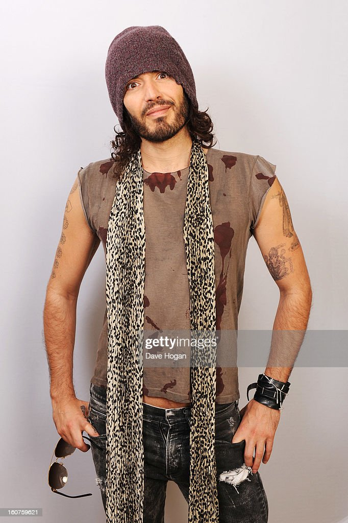 Russell Brand poses for portraits to promote his gig at Wembley Arena on 6th March in aid of Comic Relief at The Savoy Hotel on January 31, 2013 in London, England.