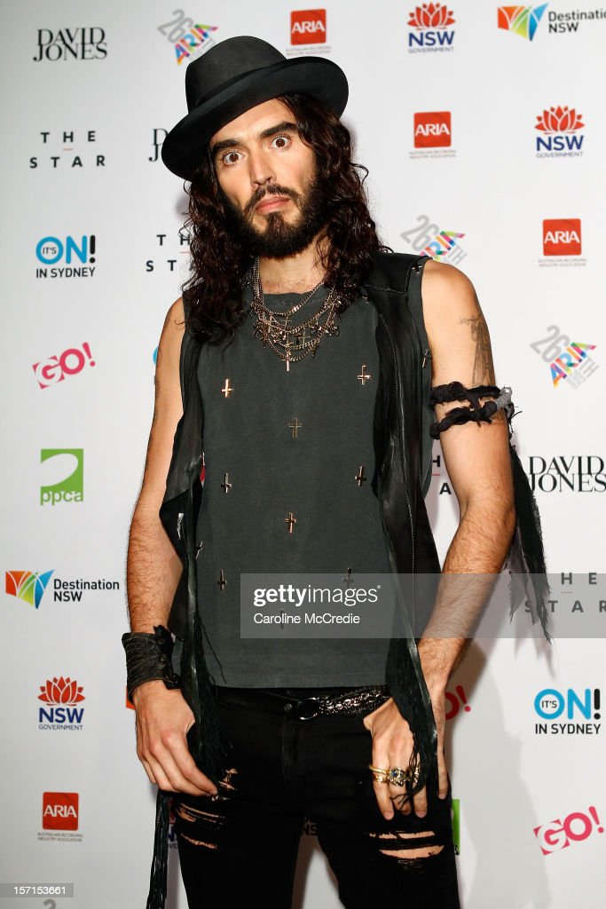 <a gi-track='captionPersonalityLinkClicked' href=/galleries/search?phrase=Russell+Brand&family=editorial&specificpeople=536593 ng-click='$event.stopPropagation()'>Russell Brand</a> poses in the awards room at the 26th Annual ARIA Awards 2012 at the Sydney Entertainment Centre on November 29, 2012 in Sydney, Australia.