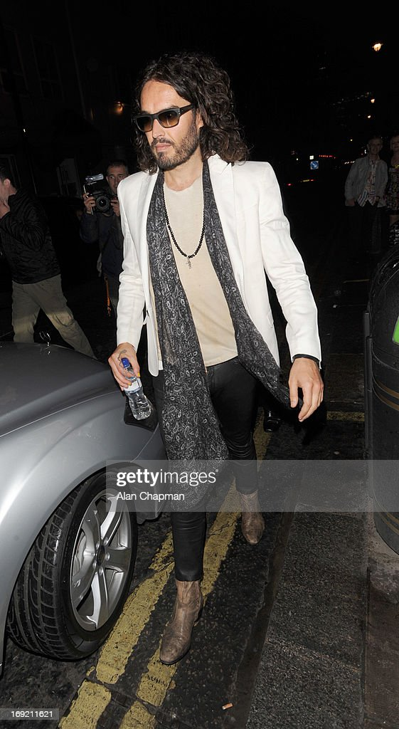 <a gi-track='captionPersonalityLinkClicked' href=/galleries/search?phrase=Russell+Brand&family=editorial&specificpeople=536593 ng-click='$event.stopPropagation()'>Russell Brand</a> sighting leaving the Soho Theatre in Dean Street Soho on May 21, 2013 in London, England.