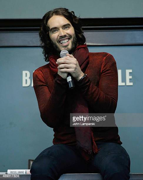 Russell Brand signs copies of his book 'The Pied Piper Of Hamelin' at Barnes Noble Union Square on November 20 2014 in New York City