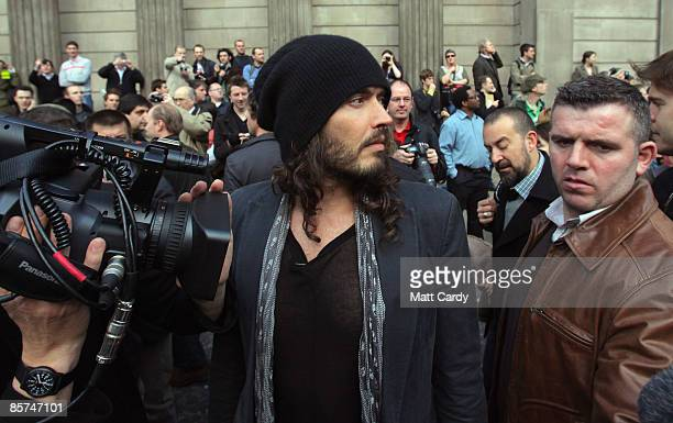 Russell Brand watches as anti capitalist and climate change activists demonstrate in the City of London on April 1 2009 in London England Protesters...