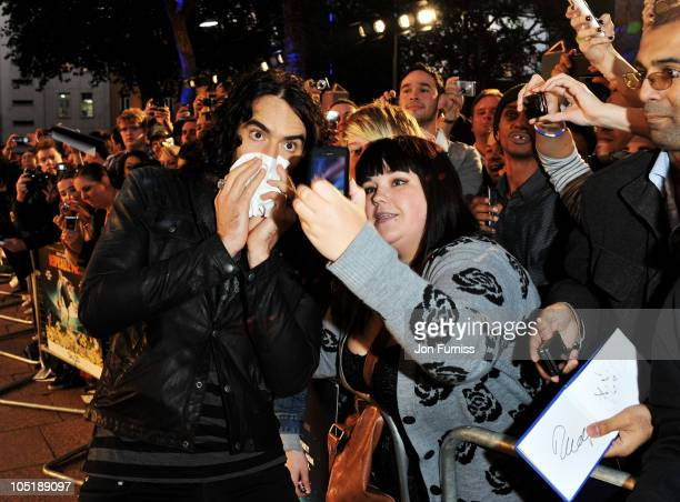Russell Brand with fans at the 'Despicable Me' European premiere at Empire Leicester Square on October 11 2010 in London England