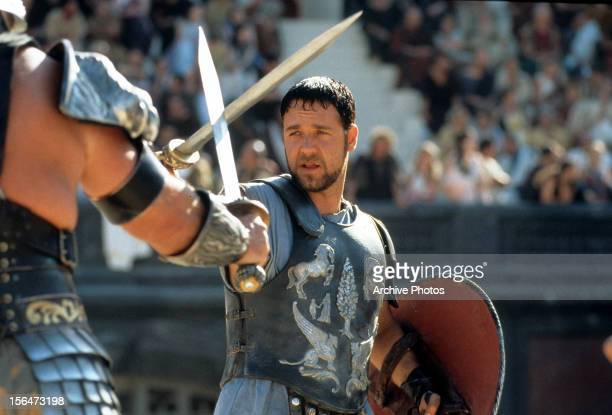 Russell Crowe facing off against another man in a scene from the film 'Gladiator' 2000