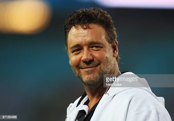 Russell Crowe smiles to the crowd during the Rabbitohs warmup before the NRL Charity Shield match between the South Sydney Rabbitohs and the St...