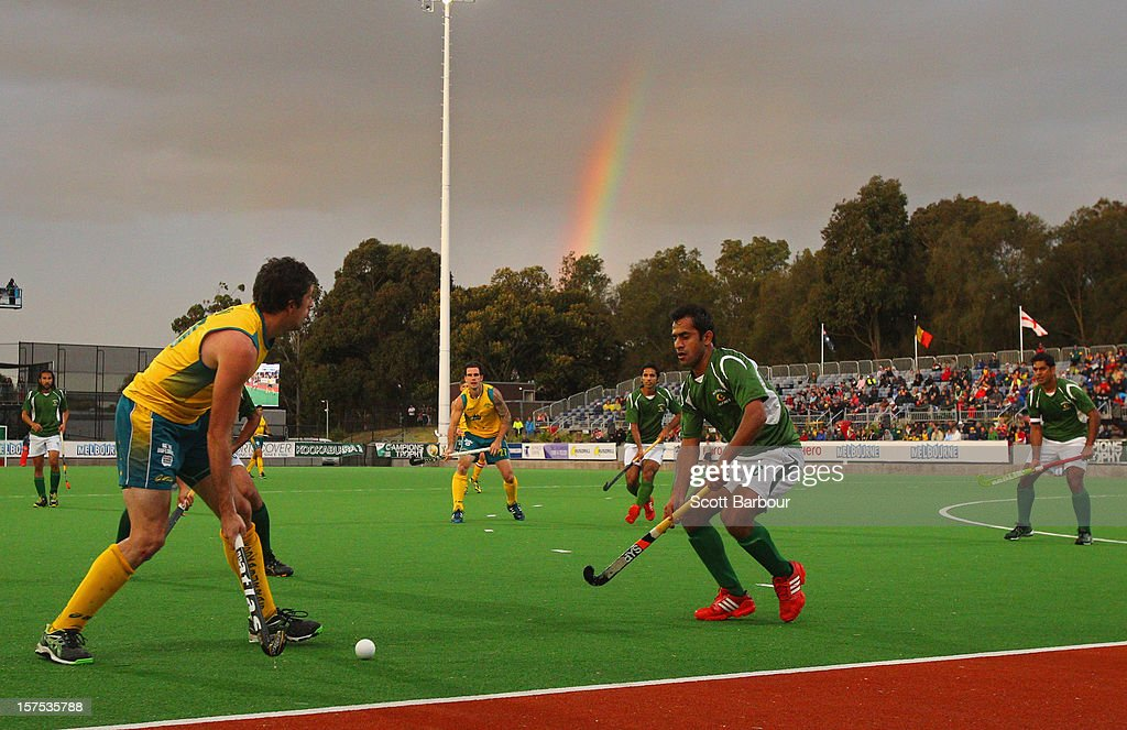 Russell Ford of Australia looks to pass the ball as a rainbow appears during the match between the Australia and Pakistan during day three of the Champions Trophy at the State Netball Hockey Centre on December 4, 2012 in Melbourne, Australia.