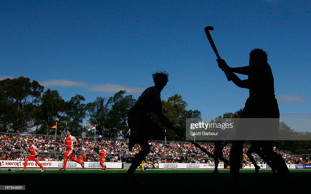 Russell Ford (R) of Australia passes the ball during the match between Australia and the Netherlands during day two of the Champions Trophy on December 2, 2012 in Melbourne, Australia.