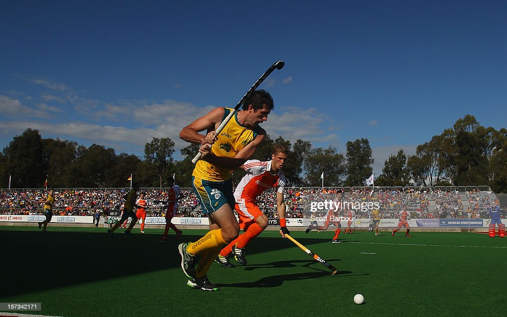 Russell Ford of Australia prepares to hit the ball during the match between Australia and the Netherlands during day two of the Champions Trophy on December 2, 2012 in Melbourne, Australia.