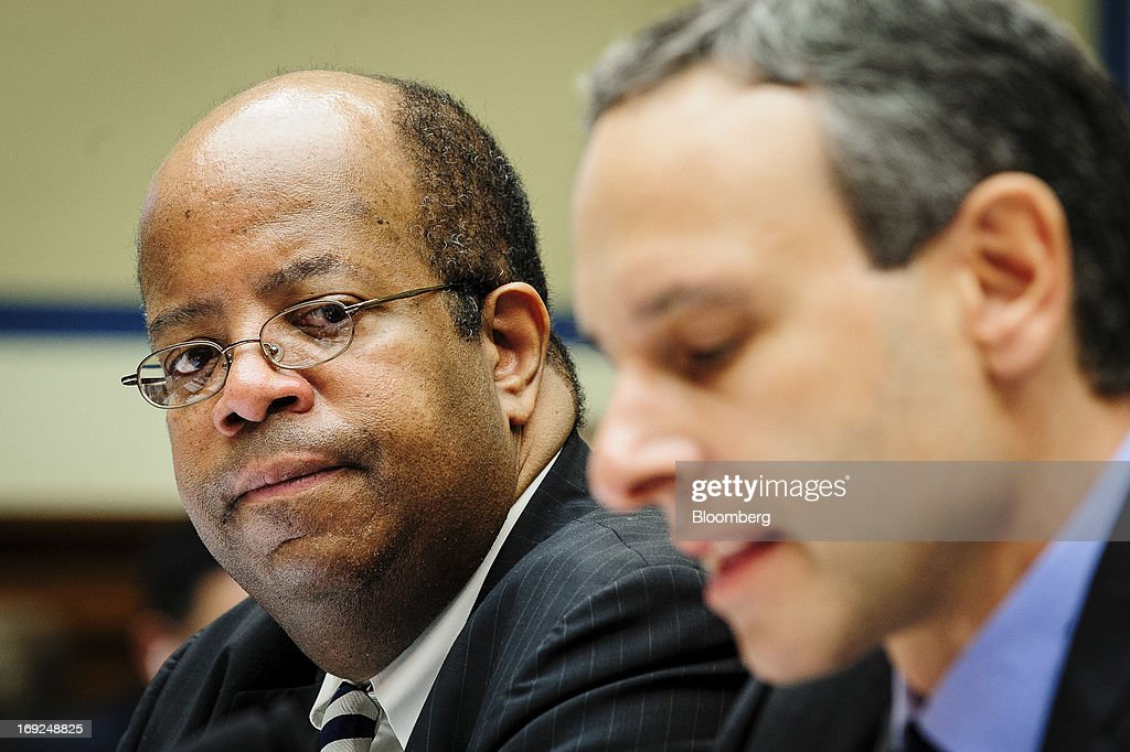 J Russell George US Treasury inspector general for tax administration left looks on as Douglas Shulman former commissioner of the Internal Revenue...