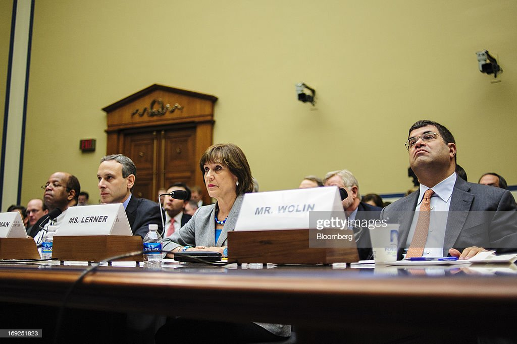 J. Russell George, U.S. Treasury inspector general for tax administration, from left, Douglas Shulman, former commissioner of the Internal Revenue Service (IRS), Lois Lerner, the director of the Internal Revenue Service's (IRS) exempt organizations office, and Neal S. Wolin, deputy secretary of the Treasury, listen during a House Oversight and Government Reform Committee hearing in Washington, D.C., U.S., on Wednesday, May 22, 2013. Lerner, the mid-level IRS official at the center of a controversy over treatment of small-government groups, invoked her right not to testify after reading a statement denying that she had committed any crimes. Photographer: Pete Marovich/Bloomberg via Getty Images