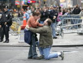 Russell Greller of Levitown New York proposes to his fiance Sarah Dowling in the middle of Times Square before the start of Macy's Thanksgiving Day...