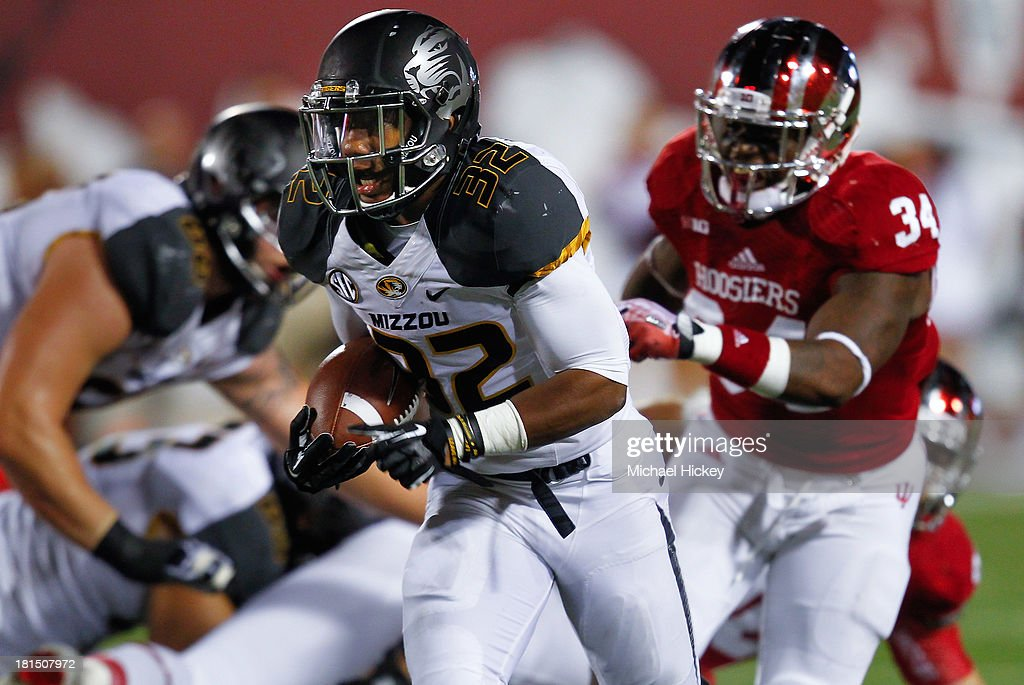 Russell Hansbrough #32 of the Missouri Tigers runs the ball for a touchdown against the Indiana Hoosiers at Memorial Stadium on September 21, 2013 in Bloomington, Indiana. Missouri defeated Indiana 45-28.