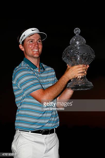 Russell Henley celebrates with the trophy after winning The Honda Classic at PGA National Resort and Spa on March 2 2014 in Palm Beach Gardens Florida
