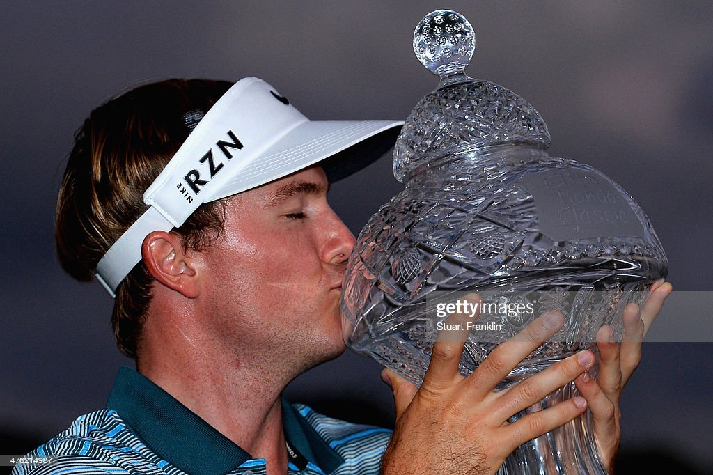 <a gi-track='captionPersonalityLinkClicked' href=/galleries/search?phrase=Russell+Henley&family=editorial&specificpeople=6919717 ng-click='$event.stopPropagation()'>Russell Henley</a> celebrates with the trophy after winning The Honda Classic at PGA National Resort and Spa on March 2, 2014 in Palm Beach Gardens, Florida.
