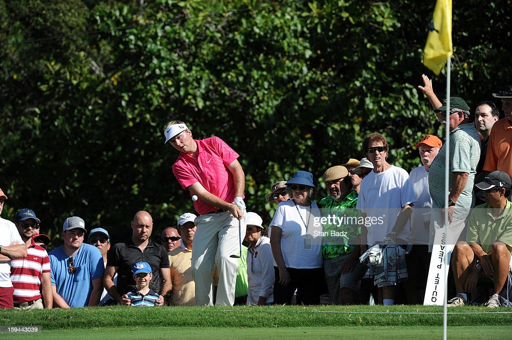 <a gi-track='captionPersonalityLinkClicked' href=/galleries/search?phrase=Russell+Henley&family=editorial&specificpeople=6919717 ng-click='$event.stopPropagation()'>Russell Henley</a> chips onto the eighth green during the final round of the Sony Open in Hawaii at Waialae Country Club on January 13, 2013 in Honolulu, Hawaii.