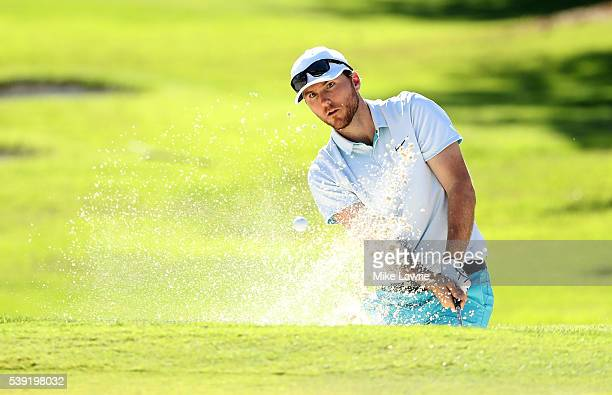 Russell Henley hits out of a bunker on the 16th hole during the second round of the FedEx St Jude Classic at TPC Southwind on June 10 2016 in Memphis...