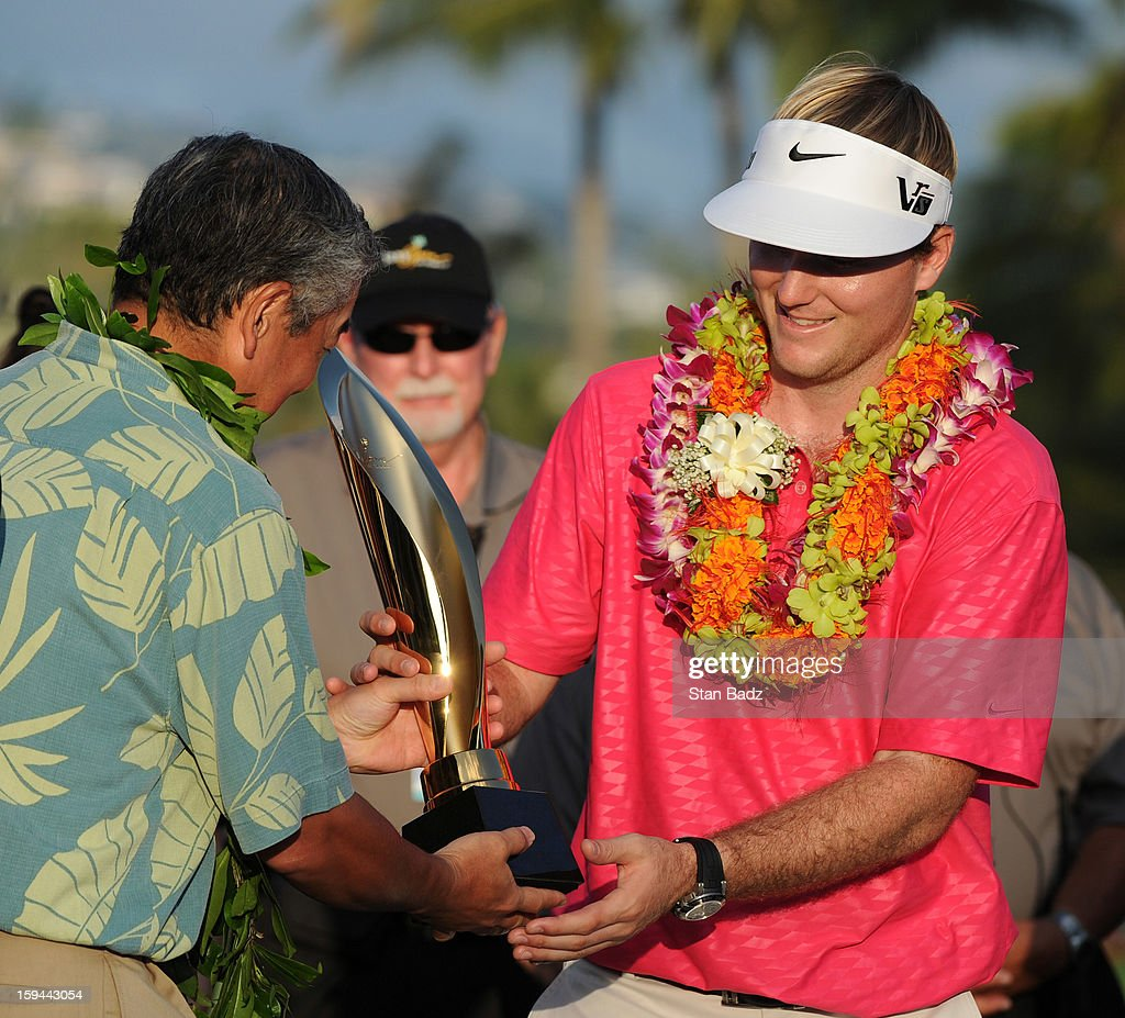 <a gi-track='captionPersonalityLinkClicked' href=/galleries/search?phrase=Russell+Henley&family=editorial&specificpeople=6919717 ng-click='$event.stopPropagation()'>Russell Henley</a> is presented the Sony Open in Hawaii trophy after winning in the final round of the Sony Open in Hawaii at Waialae Country Club on January 13, 2013 in Honolulu, Hawaii.