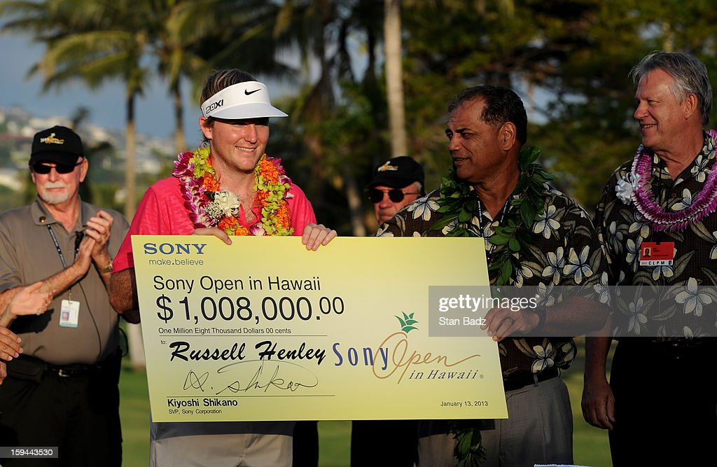 <a gi-track='captionPersonalityLinkClicked' href=/galleries/search?phrase=Russell+Henley&family=editorial&specificpeople=6919717 ng-click='$event.stopPropagation()'>Russell Henley</a> is presented winner's check during the awards ceremony of the Sony Open in Hawaii at Waialae Country Club on January 13, 2013 in Honolulu, Hawaii.