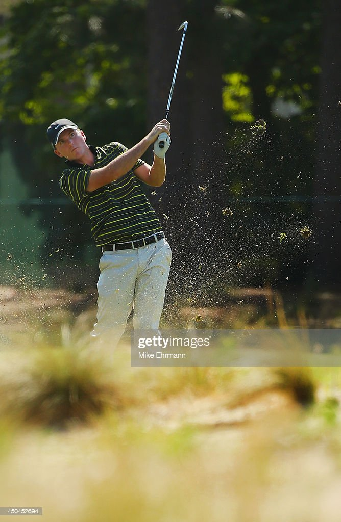 Russell Henley of the United States hits a shot during a practice round prior to the start of the 114th U.S. Open at Pinehurst Resort & Country Club, Course No. 2 on June 11, 2014 in Pinehurst, North Carolina.