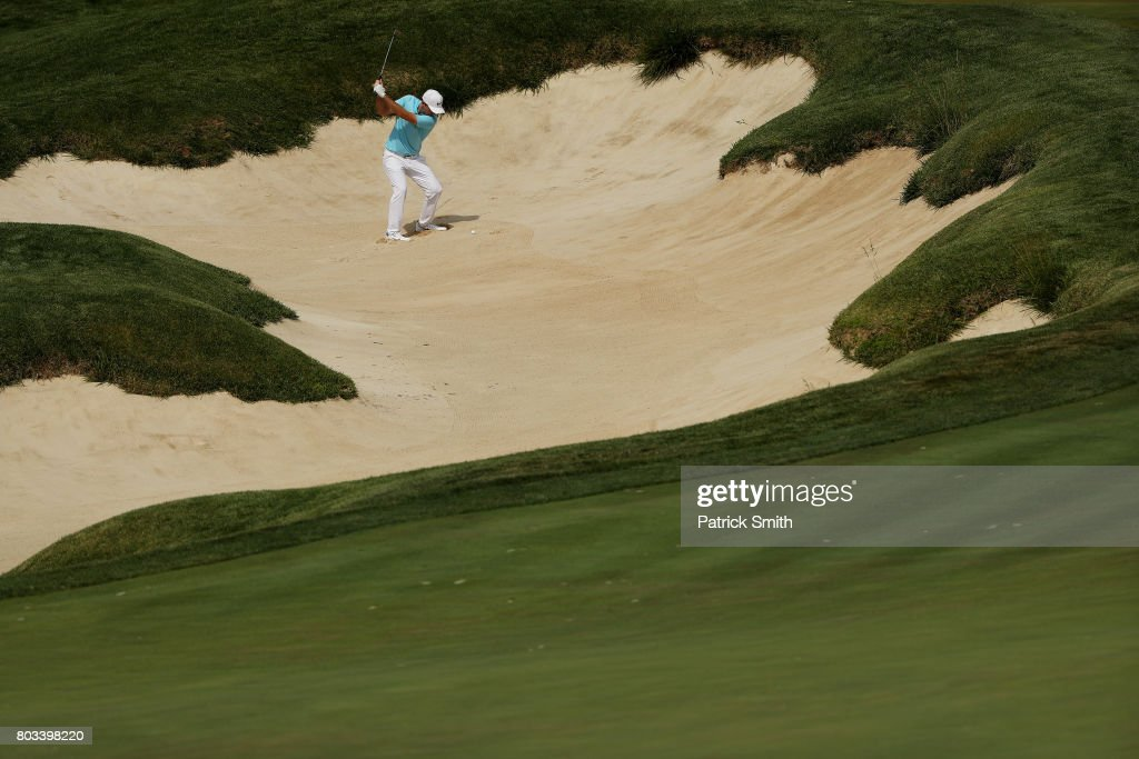Russell Henley of the United States plays a shot from a bunker on the 18th hole during the first round of the Quicken Loans National on June 29, 2017 TPC Potomac in Potomac, Maryland.