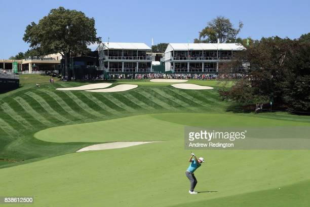 Russell Henley of the United States plays a shot on the 18th hole during round one of The Northern Trust at Glen Oaks Club on August 24 2017 in...