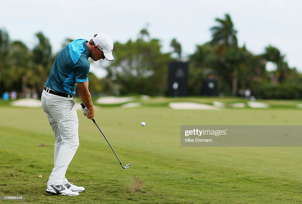 <a gi-track='captionPersonalityLinkClicked' href=/galleries/search?phrase=Russell+Henley&family=editorial&specificpeople=6919717 ng-click='$event.stopPropagation()'>Russell Henley</a> plays a shot on the 11th hole during the first round of the World Golf Championships-Cadillac Championship at Trump National Doral on March 6, 2014 in Doral, Florida.
