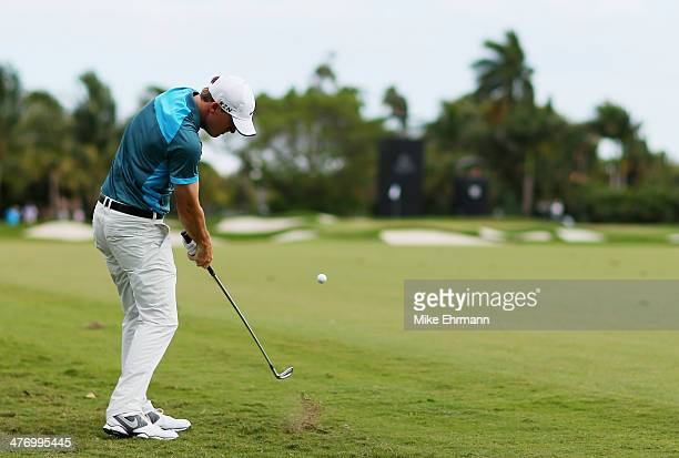 Russell Henley plays a shot on the 11th hole during the first round of the World Golf ChampionshipsCadillac Championship at Trump National Doral on...