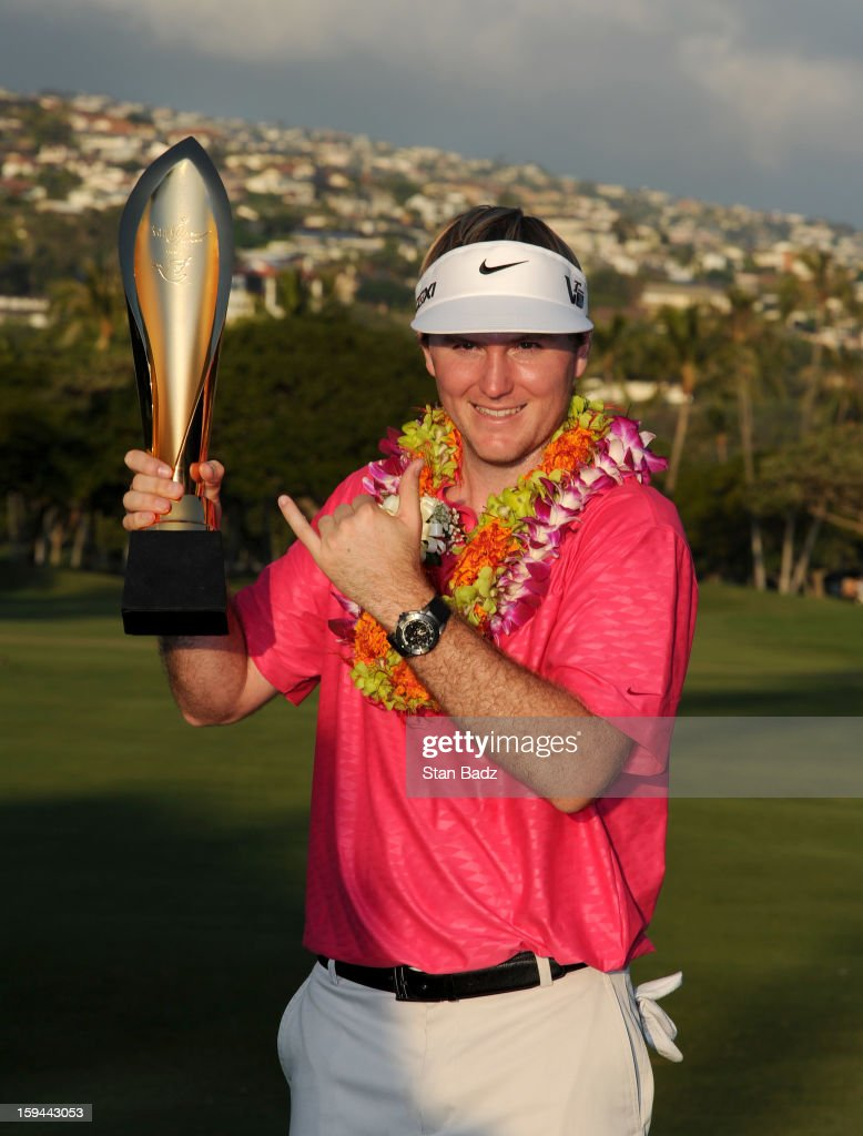Russell Henley poses with the Sony Open in Hawaii trophy after winning in the final round of the Sony Open in Hawaii at Waialae Country Club on January 13, 2013 in Honolulu, Hawaii.