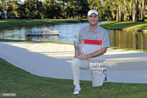 Russell Henley poses with the tournament trophy after winning the WinnDixie Jacksonville Open presented by Planters at TPC Sawgrass Dye's Valley...