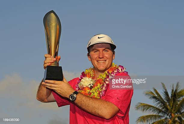 Russell Henley poses with the tournament trophy after winning the Sony Open in Hawaii at Waialae Country Club on January 13 2013 in Honolulu Hawaii