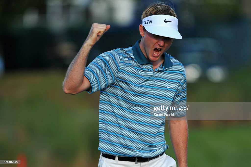 <a gi-track='captionPersonalityLinkClicked' href=/galleries/search?phrase=Russell+Henley&family=editorial&specificpeople=6919717 ng-click='$event.stopPropagation()'>Russell Henley</a> reacts during the final round of The Honda Classic at PGA National Resort and Spa on March 2, 2014 in Palm Beach Gardens, Florida.