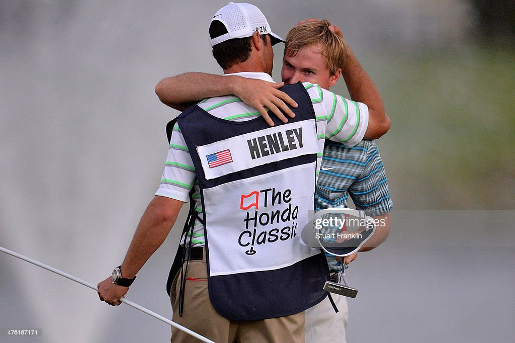 <a gi-track='captionPersonalityLinkClicked' href=/galleries/search?phrase=Russell+Henley&family=editorial&specificpeople=6919717 ng-click='$event.stopPropagation()'>Russell Henley</a> reacts with his caddie after winning a four-way playoff hole to defeat <a gi-track='captionPersonalityLinkClicked' href=/galleries/search?phrase=Rory+McIlroy&family=editorial&specificpeople=783109 ng-click='$event.stopPropagation()'>Rory McIlroy</a> of Northern Ireland, Russell Knox, and Ryan Palmer (all not pictured) to win The Honda Classic at PGA National Resort and Spa on March 2, 2014 in Palm Beach Gardens, Florida.