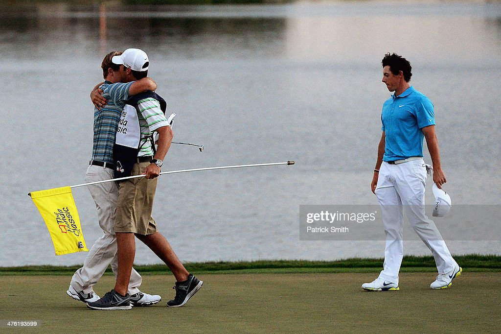 <a gi-track='captionPersonalityLinkClicked' href=/galleries/search?phrase=Russell+Henley&family=editorial&specificpeople=6919717 ng-click='$event.stopPropagation()'>Russell Henley</a> reacts with his caddie (L) after winning a four-way playoff hole to defeat <a gi-track='captionPersonalityLinkClicked' href=/galleries/search?phrase=Rory+McIlroy&family=editorial&specificpeople=783109 ng-click='$event.stopPropagation()'>Rory McIlroy</a> of Northern Ireland (R), Russell Knox, and Ryan Palmer (both not pictured) to win The Honda Classic at PGA National Resort and Spa on March 2, 2014 in Palm Beach Gardens, Florida.