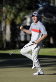 Russell Henley sinks a birdie putt to force a playoff during the final round of the the WinnDixie Jacksonville Open presented by Planters at TPC...