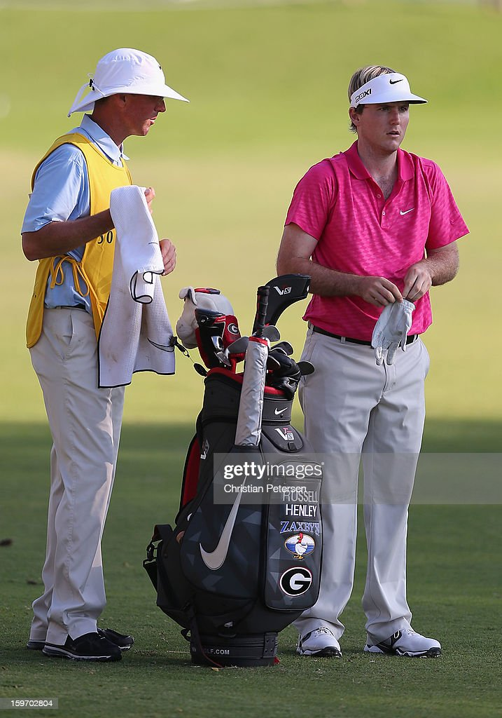 Russell Henley stands with his caddie and bag during the final round of the Sony Open in Hawaii at Waialae Country Club on January 13, 2013 in Honolulu, Hawaii.