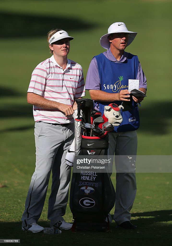 Russell Henley stands with his caddie and bag during the second round of the Sony Open in Hawaii at Waialae Country Club on January 11, 2013 in Honolulu, Hawaii.