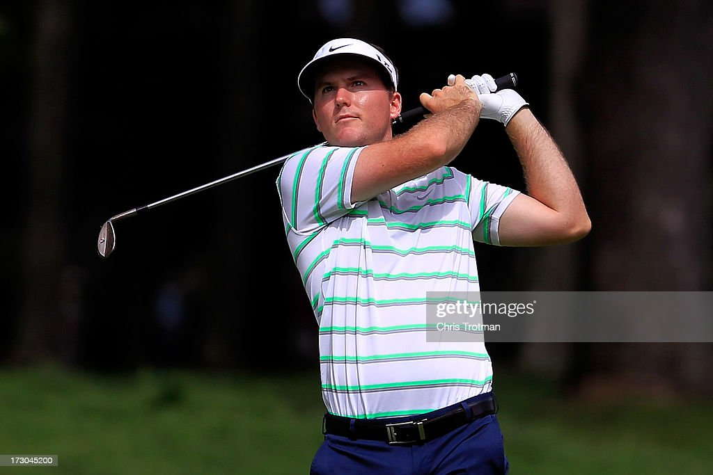 <a gi-track='captionPersonalityLinkClicked' href=/galleries/search?phrase=Russell+Henley&family=editorial&specificpeople=6919717 ng-click='$event.stopPropagation()'>Russell Henley</a> watches his second shot to the 4th hole during round two of the Greenbrier Classic at the Old White TPC on July 5, 2013 in White Sulphur Springs, West Virginia.